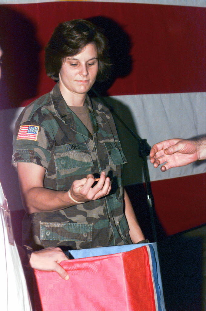 1ST Lieutenant Jennifer Jones, 55th Signal Company, draws a number from the box for the raffle during the July 4th celebration at the Allied Command Europe Rapid Reaction Corps Headquarters site in the Sarajevo suburb of Ilidza