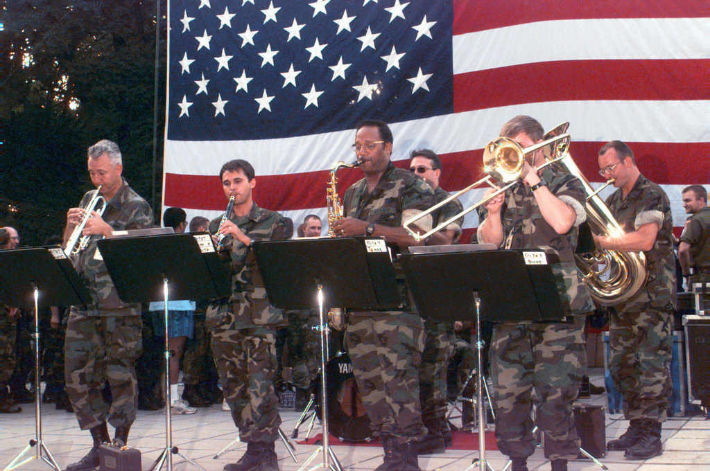 Members of the CINCSOUTH NATO Band play at the Allied Command Europe Rapid Reaction Corps Headquarters site in the Sarajevo suburb of Ilidza during the July 4th celebration. (Duplicate image, see also DASD9903193 or search 960704A4605G002)