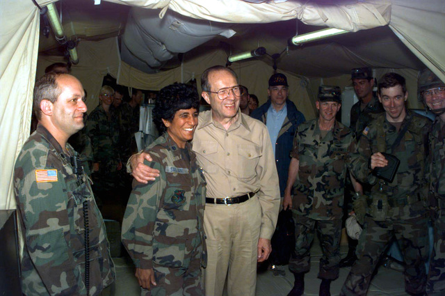 The Honorable William J. Perry, Secretary of Defense, takes a moment to pose for a picture with US Air Force Lieutenant Colonel (LTC) Sabjani, chief surgeon, temporarily assigned to 30th Medical Brigade, 212th Mash Unit, Camp Bedrock, Bosnia-Herzegovina
