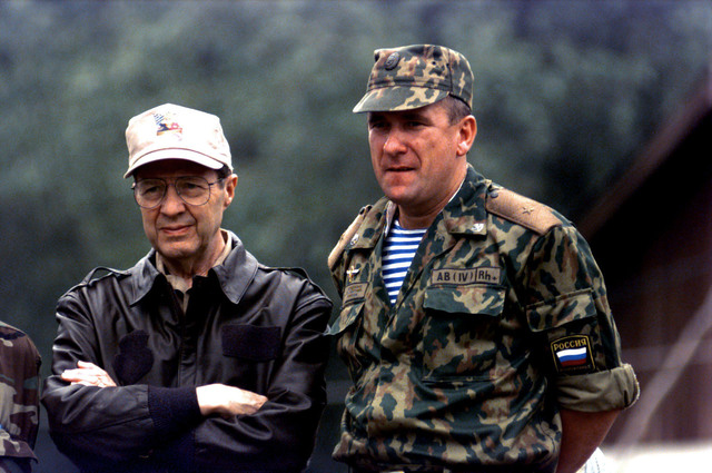United States Secretary of Defense William J. Perry and Russian General Major Alexandr Lentsov, Commander, Russian Brigade, watch a demonstration of hand to hand combat techniques used by the Russian soldiers (not shown). Secretary Perry watched the demonstration during his visit to the Russian Brigade Headquarters at Ugljevik, Bosnia and Herzegovina during Operation JOINT ENDEAVOR