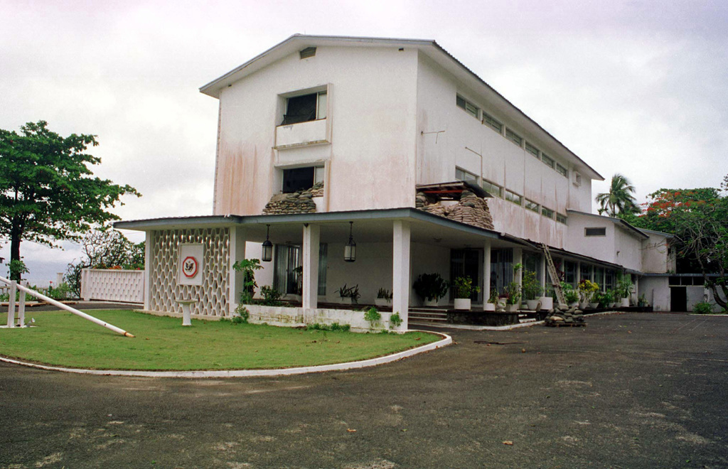 A view of the south side entrance to the US Embassy Ambassadors residence in Monrovia, Liberia with Marine defensive positions visible. During Operation ASSURED RESPONSE Marines from the 2ND Marine Expeditionary Unit (MEU) Camp Lejeune, NC took over the security mission at the embassy