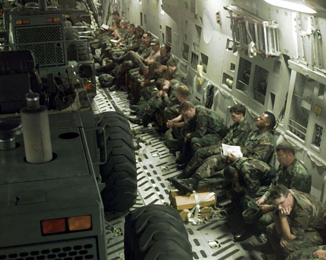 Inside the cargo hold of the C-17, the Hurricane Response Force personnel sit on the C-17 seats sharing the space with their equipment. They are enroute from McGuire Air Force Base, New Jersey to Charleston Air Force Base, South Carolina to assist with any damage caused by Hurricane Bertha