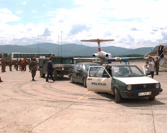Queen Noor, the Queen of Jordan, arrived at Tuzla Air base, in Bosnia-Herzegovina, during Operation JOINT ENDEAVOR (the multi-national peacekeeping mission in Bosnia) to attend a Womens conference held to bring awareness to the plight of the women of Serbenica who were forced to leave their homes. The fate of their husbands and sons are unknown; they are believed to be dead and buried in mass graves. The conference was also to show solidarity of the women of Bosnia and the world. Shown here is the motorcade provided to move the Queen, as well as many other well known women, to the Sports center in Tuzla