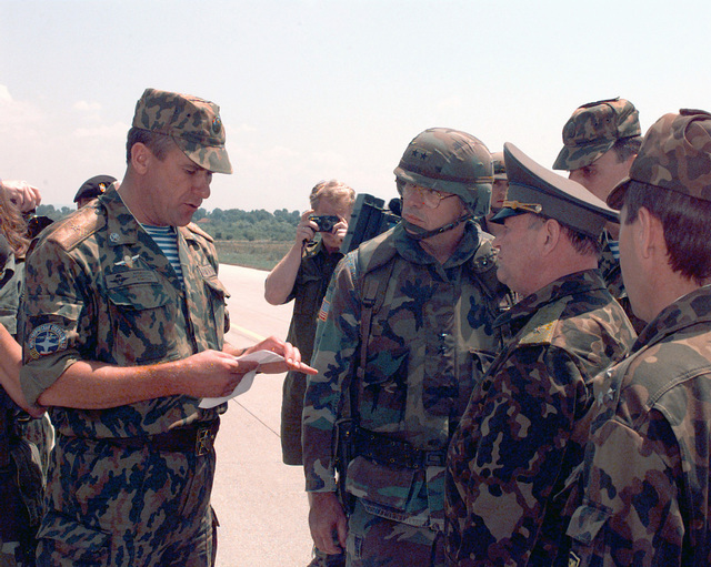 General Major Alexandr Lentsov, Commanding Officer of the Russian Brigade located in Uglievick, Bosnia - Herzegovina in Task Force Eagle during Operation JOINT ENDEAVOR (the multi-national peacekeeping mission in Bosnia), reads a prepared statement to Major General William L. Nash, Commanding General of Task Force Eagle, after an informal ceremony held at the airfield on Tuzla Air Base, where MGEN Nash awarded Russian soldiers with the NATO medal before their return to Russia