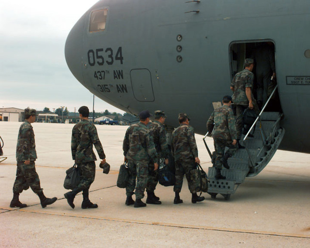 Members of the Hurricane Response Team, carrying their bags board a C-17 Globemaster III, from the 437th Airlift Wing, Charleston Air Force Base, South Carolina. They will fly to Charleston Air Force Base, South Carolina to assist with damage caused by Hurricane Bertha. SCREEN RESOLUTION ONLY