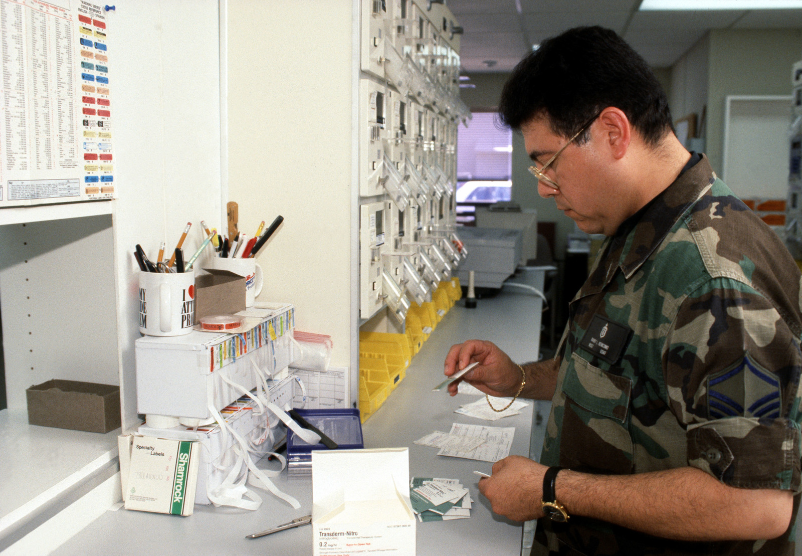 In the pharmacy at the Los Angeles Air Force Base clinic, MASTER Sergeant Randy L. Bencomo with the 61st Medical Squadron fills one of many prescriptions