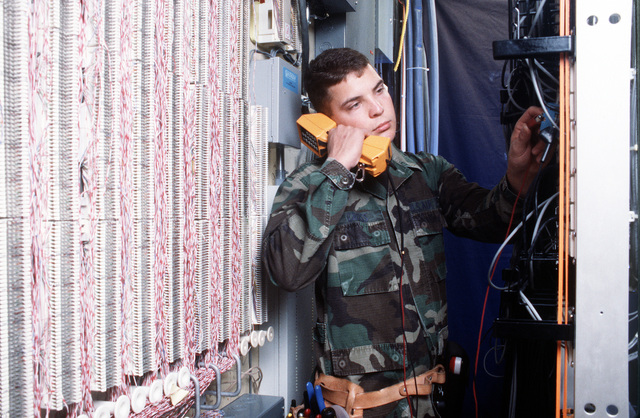 SENIOR AIRMAN John Cross, from the 61st Communications Squadron, 61st Air Base Group, repairs phone lines at Los Angeles Air Force Base, California