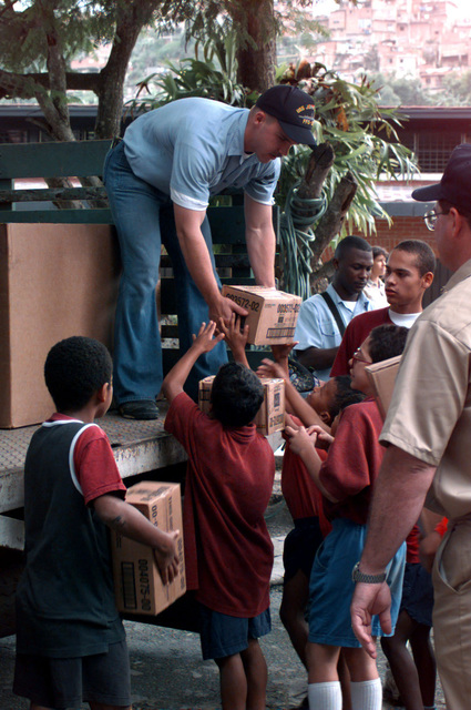 The US Navy's community relations project Project Hands clasp reaches out to needy children in Caracas, Venezuela. US Sailors from ship's participating in UNITAS 37-96 off-load needed supplies donated to the orphanage, Casa Hogar De Domingo. UNITAS is an annual operation in which a US Navy task group conduct combined exercises with participating navies. The task group for UNITAS 37-96 include the frigate USS JOHN L. HALL (FFG 32) (not shown), tank landing ship USS LA MOURE COUNTY (LST 1194) (not shown) and the attack submarine USS NARWHAL (SSN 671) (not shown)
