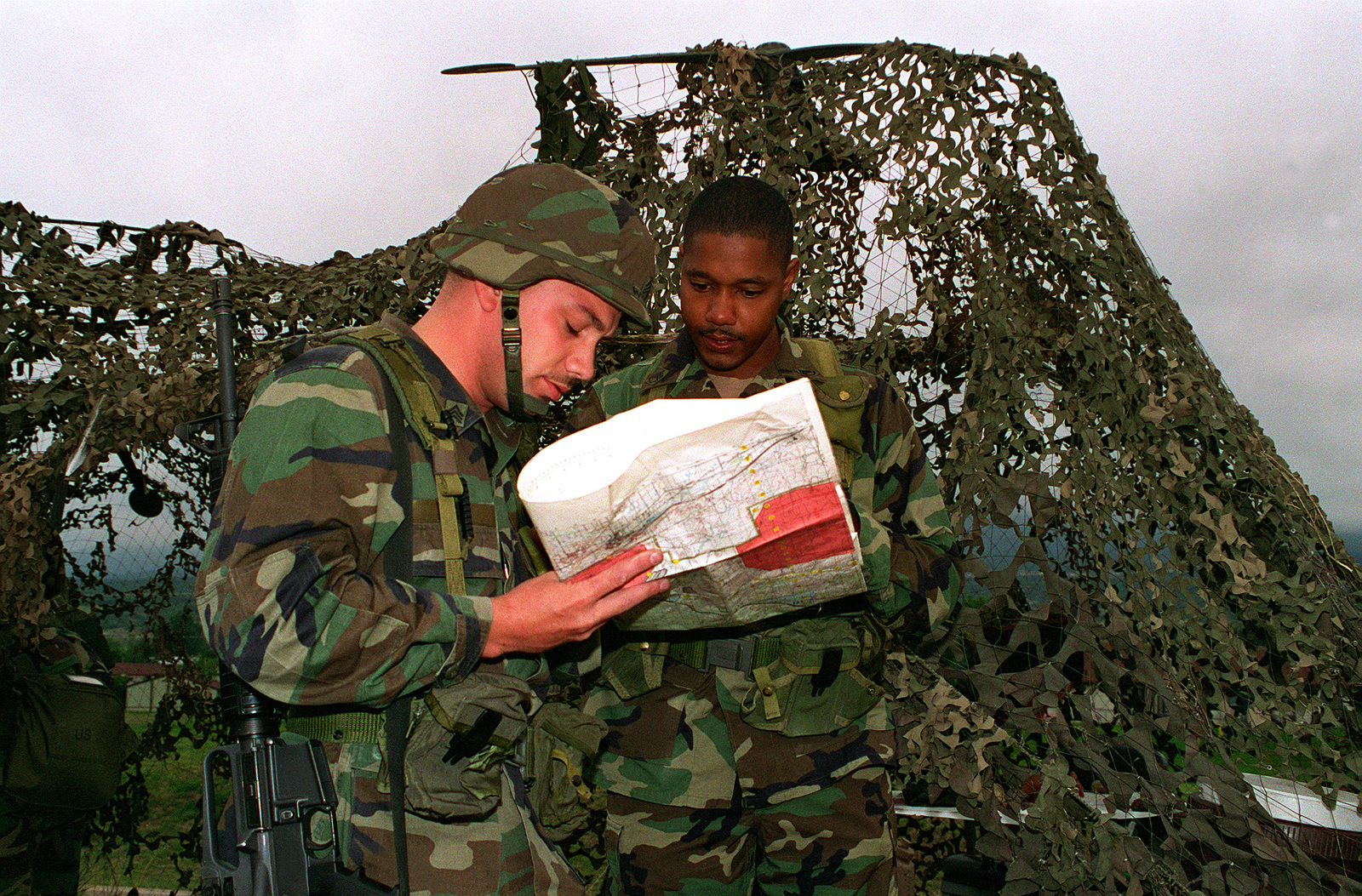 SGT. Kenneth P. Wise, 52nd Engineers, is given a standard 1:50,000-Scale Military Map in a field location to determine the six digit grid coordinates for the point on the map with a 100 meter tolerance. The training was done during sergeants time