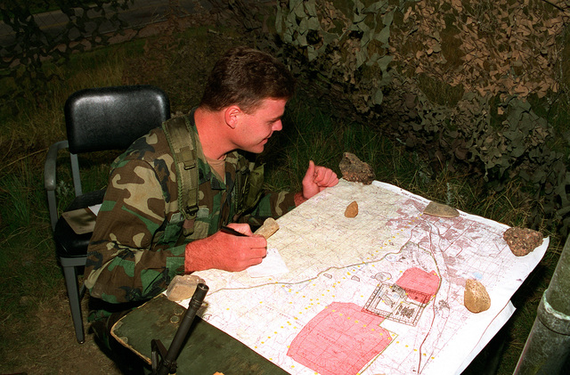 SPC. Case McCall from Headquarters and Service Company (HSC), 52nd Engineers, is given a standard 1:50,000-Scale Military Map in a field location to determine the six digit grid coordinates for the point on the map with a 100 meter tolerance. The training was done during sergeants time