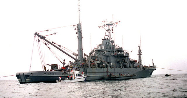 The Salvage and Rescue ship USS GRASP (ARS 51) operates in Moriches Inlet, Long Island, New York, in support of US Navy diving and recovery efforts where the ill-fated TWA flight 800 crashed on July 17, 1996