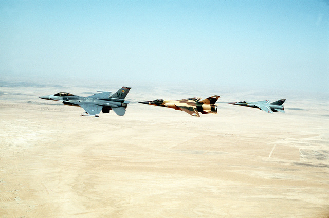 A 68th Fighter Squadron F-16 from Moody AFB, GA, leads two Royal Jordanian Air Force F-1 Mirages, one painted gray and the other a desert camouflage, on a training sortie over the desert in Jordan near the Iraqi border. Exact Date Shot Unknown Published in AIRMAN Magazine August 1996