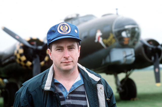 """MASTER SGT. Mark Brotherton, an 8th Air Force buff, stands in front of the B-17 used in the film """"Memphis Belle,"""" which is on display at the Duxford Air Museum. Exact Date Shot Unknown Published in AIRMAN Magazine August 1996"""