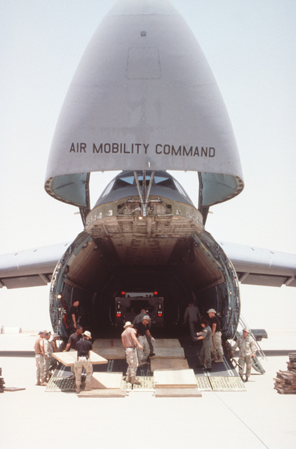 MASTER Sergeant Pam Barnes, a loadmaster on a C-5B Galaxy aircraft based at the 22nd Airlift Squadron, Travis Air Force Base, California points where to place load absorbing boards before a vehicle travels down the ramp. The continued operations are supplying personnel and equipment into the base. This is the relocation of Operation Southern Watch from Dhahran after a terrorist bomb killed 19 Air Force personnel in June