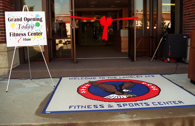 The entrance, before the red ribbon is cut to the new base gym after a year and a half of renovations at a cost of one million dollars. It is equipped with all new free weights, nautilus machines, and cardiovascular equipment