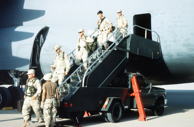 Various Air Force Support personnel such as Security Police, Services and Finance Specialists exit the aircraft upon their arrival. This is the relocation of Operation Southern Watch and the 4404th Wing (Provisional ) from Dhahran after a terrorist bomb killed 19 Air Force personnel in June