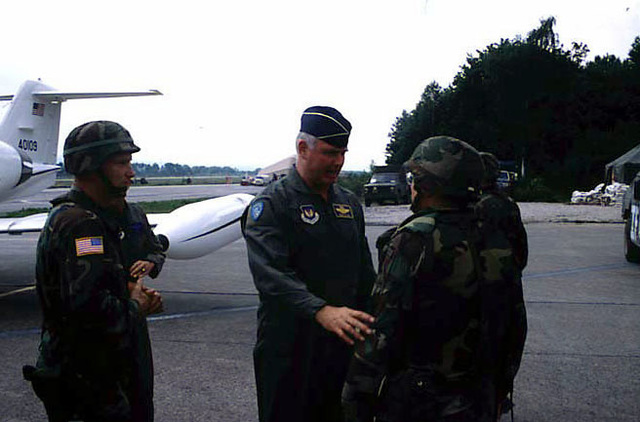 BGEN George Casey (USA), Assistant Division Commander (Maneuvers), 1ST Armored Division, and COL Paul Cooper (USAF), Commander 4100th Group Provisional, greets GEN Michael A. Ryan (USAF), CINC USAFE, upon his arrival at Tuzla AB, Bosnia-Herzegovina, during his visit to Bosnia during Operation Joint Endeavor. Operation Joint Endeavor is a peacekeeping effort by a multinational Implementation Force (IFOR), comprised of NATO and non-NATO military forces, deployed to Bosnia in support of the Dayton Peace Accords