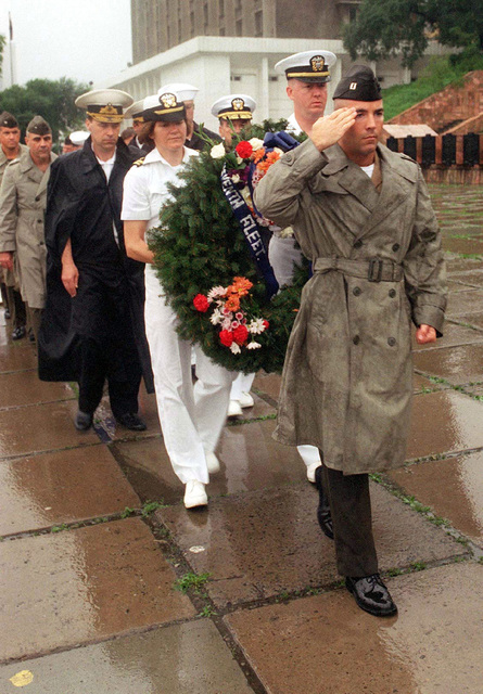 US Navy Captain Jim Munroe, Radio Officer, US Navy amphibious assault ship USS BELLEAU WOOD (LHA 3), leads a group of US officers taking part in a wreath laying ceremony at a World War II memorial in Vladivostok, Russia. Belleau Wood is in the Russian Far East to participate in Exercise COOPERATION FROM THE SEA '96. The exercise is a joint venture between US and Russian Naval forces designed to improve disaster-relief operations and to gain further understanding between the two nations