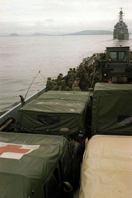 A US Navy Utility Landing Craft (LCU) loaded with medical vehicles and supplies for a simulated disaster-relief exercise follows a Russian Ropucha II Class (Type B 23) Landing ship, Tank during Exercise COOPERATION FROM THE SEA '96, near Vladivostok, Russia. The exercise is a joint venture between US and Russian naval forces designed to improve disaster-relief operations and to further understanding between the two nations