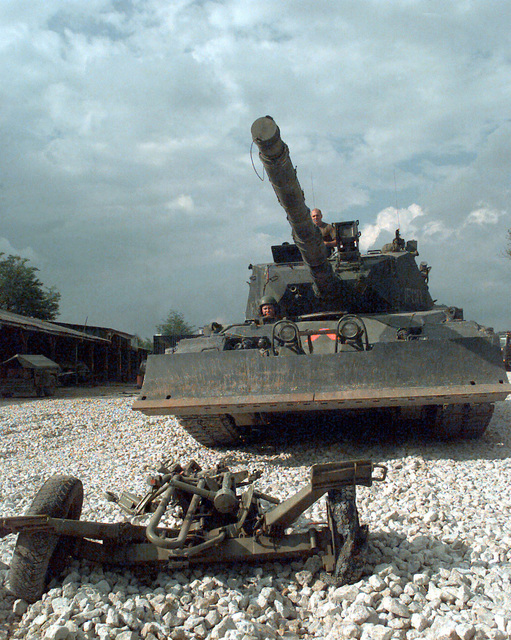 A destroyed Serbian 20/3mm M55 A4 B1 Anti-aircraft Gun carriage lies on the ground in front of a Krauss-Maffei Leopard 1A5 Main Battle Tank Dozer at Danver Camp (DANBAT) in Doboj, Bosnia-Herzegovina. The M55 was destroyed during Joint Endeavor which is a peacekeeping effort by a multinational Implementation (IFOR), comprised of NATO and non-NATO military forces, deployed to Bosnia in support of the Dayton Peace Accords