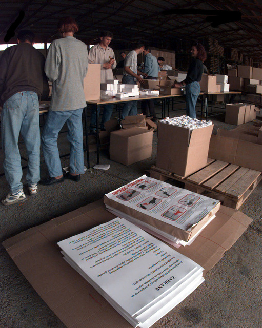 Posters with information for the Polling centers are included into the kits at the Organization for Security and Co-operation in Europe Mission to Bosnia and Herzogovina warehouse for the upcoming elections in Sarajevo, Bosnia and Herzegovina, during Operation JOINT ENDEAVOR