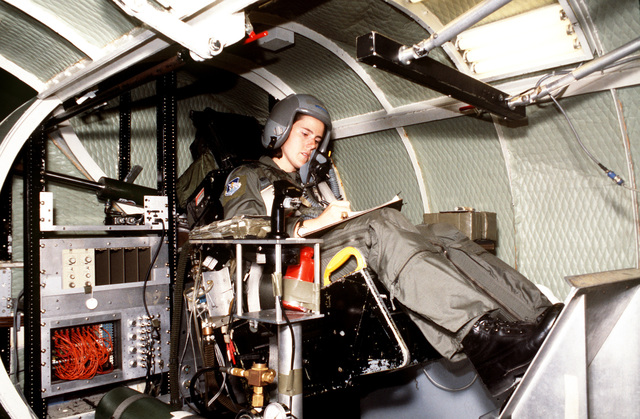 1ST LT. Heather M. Alexander sits in the gondola at the physiology chamber and completes her paperwork before testing a new G-suit and the ability to tolerate various G-forces. LT. Alexander is a veteran with over 500 exposures dating to November 1993