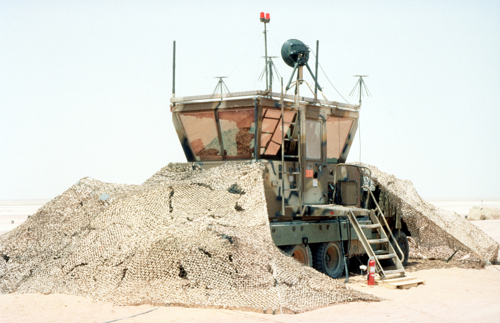 The TSW -7 Mobile Tower is operated by members of the 5th Combat Communications Group from Robbins Air Force Base Georgia. Soon this site will be controlling all arriving and departing aircraft bringing troops, equipment and supplies in support of the relocation of Operation Southern Watch and the 4404th Wing (Provisional) from Dhahran after a terrorist bomb attack killed 19 Air Force personnel