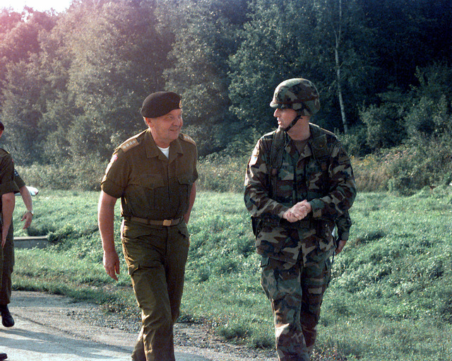Norwegian CHIEF of Defense General Solli leaves the flight line on Tuzla Air Base, Bosnia and Herzegovina, upon his arrival to Task Force Eagle for a briefing at the Division and a visit to the Nordic - Polish Brigade during Operation JOINT ENDEAVOR
