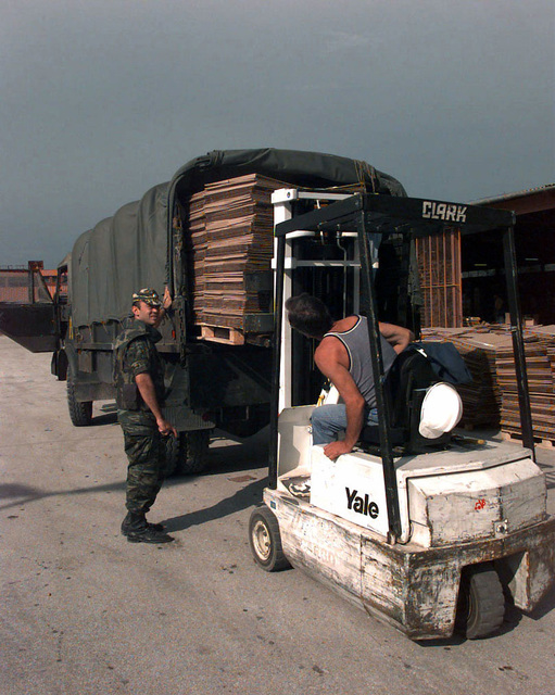 An OSCE (Organization for Security and Cooperation in Europe) staff member drives a forklift to load a pallet carrying polling kits on to a Greek Army IFOR transport vehicle. These kits are shipped throughout Bosnia-Herzegovina for the upcoming elections taking place during Operation Joint Endeavor. Operation Joint Endeavor is a peacekeeping effort by a multinational Implementation Force (IFOR), comprised of NATO and non-NATO military forces, deployed to Bosnia in support of the Dayton Peace Accords