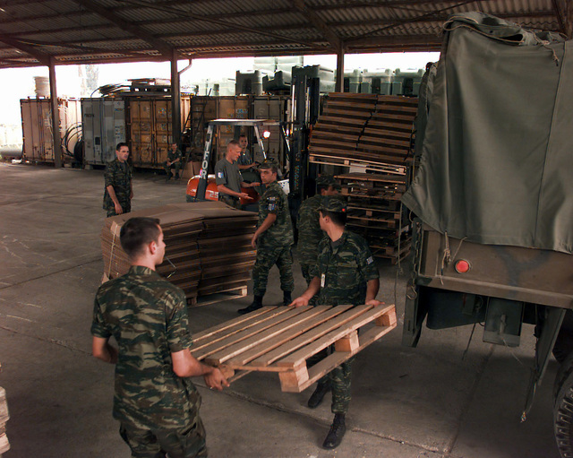 Finnish Army soldiers, Finland Army Construction Battalion, offload OSCE (Organization for Security and Cooperation in Europe) provided polling kits from the back end of a Greek Army Steyr 680 M (4x4) 4500 kg Truck inside a warehouse. These polling kits are for the upcoming elections to be held in Doboj, Bosnia-Herzegovina, during Operation Joint Endeavor. Operation Joint Endeavor is a peacekeeping effort by a multinational Implementation Force (IFOR), comprised of NATO and non-NATO military forces, deployed to Bosnia in support of the Dayton Peace Accords