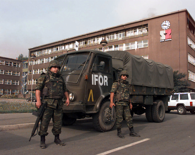 Two Greek Army soldiers, both armed with 7.62mm G3A4 Rifles, stand in front of a Greek Army, IFOR marked, Steyr 680 M (4x4) 4500 kg Truck that is carrying OSCE (Organization for Security and Cooperation in Europe) provided polling kits for the upcoming elections to be held in Zenica, Bosnia-Herzegovina, during Operation Joint Endeavor. Operation Joint Endeavor is a peacekeeping effort by a multinational Implementation Force (IFOR), comprised of NATO and non-NATO military forces, deployed to Bosnia in support of the Dayton Peace Accords