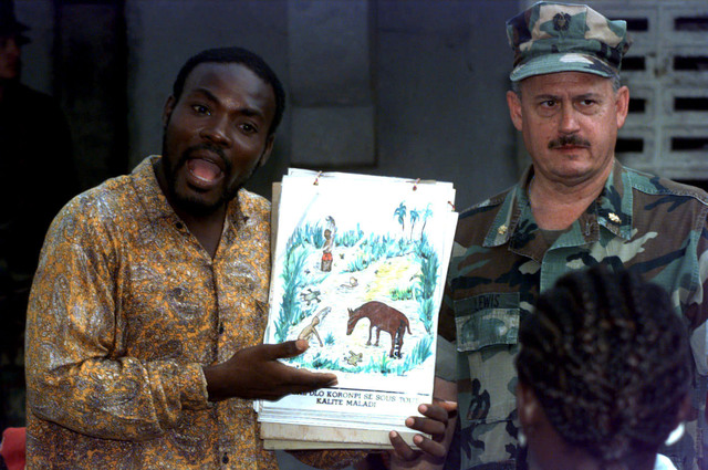 US Navy Lieutenant Commander Charles Lewis, Environmental Health Officer, with the help of an interpreter, gives a class on preventive medicine during Exercise FAIRWINDS '96, a humanitarian relief operation, in Port-au-Prince, Haiti