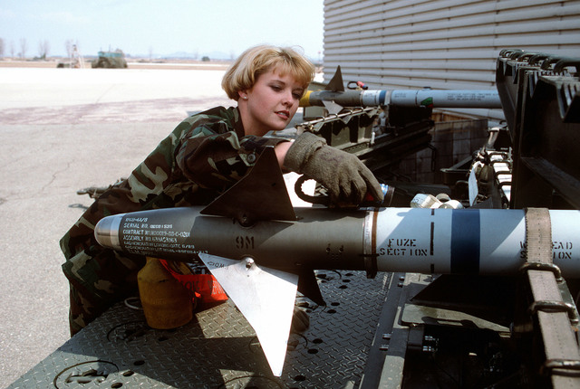 SENIOR AIRMAN Sarah Esparza, 51st Maintenance Squadron, 51st Fighter Wing, inspects AIM-9 Sidewinder training missiles. Exact Date Shot Unknown Published in AIRMAN Magazine September 1996