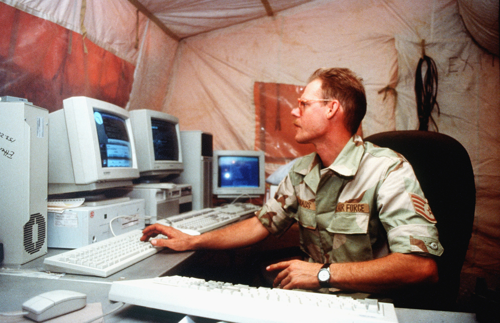 STAFF Sergeant Larry Gerads, a Computer Communications Technician, 38th Engineering and Installation Wing, Tinker Air Force Base, Oklahoma, works on the Deployed Local Area Network or DLAN, a computer service for Prince Sultan Air Base. Sergeant Gerads is providing communications support during the relocation of the 4404th Wing (Provisional) from Dhahran after a terrorist bomb attack killed 19 Air Force personnel