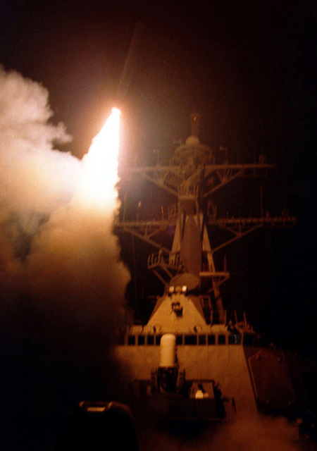 A Tomahawk Cruise Missile launches from the bow of the US Navy's Arleigh Burke class destroyer USS RUSSELL (DDG 59) in the Persian Gulf, during the initial hours of Operation DESERT STRIKE. The operation called for the tactical bombing of military targets in response to Iraqi aggression in Kurdish controlled Northern Iraq. Russell is part of the battle group assigned to the aircraft carrier USS CARL VINSON ( CVN 70) (not shown) Task Group