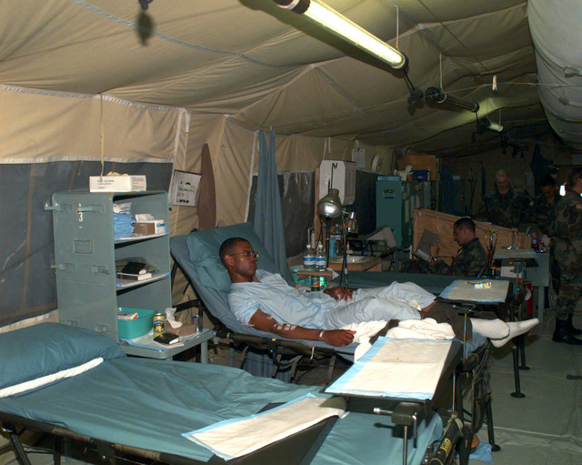 A US Army soldier recovers from an injury in one of the 2121st Mobile Army Medical Hospital (US Army) patient recovery area inside the medical facility at Camp Bedrock, located near Tuzla, Bosnia-Herzegovina. This facility primarily supports US troops involved in Operation Joint Endeavor, which is a peacekeeping effort by a multinational Implementation (IFOR), comprised of NATO and non-NATO military forces, deployed to Bosnia in support of the Dayton Peace Accords. (Duplicate image, see also DD-SD-00-00362 or search 960904-A-2645M-063)