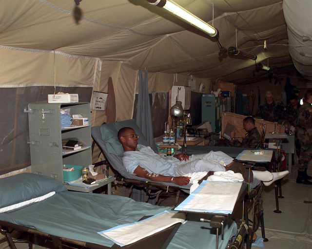 A US Army soldier recovers from an injury in one of the 2121st Mobile Army Medical Hospital (US Army) patient recovery area inside the medical facility at Camp Bedrock, located near Tuzla, Bosnia-Herzegovina. This facility primarily supports US troops involved in Operation Joint Endeavor, which is a peacekeeping effort by a multinational Implementation (IFOR), comprised of NATO and non-NATO military forces, deployed to Bosnia in support of the Dayton Peace Accords. (Duplicate image, see also DA-SD-99-03198 or search 960904-A-2645M-063)