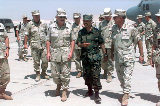 General J.H. Binford Peay III (left), Commander in CHIEF of US Central Command, MacDill AFB, Florida, is welcomed by Saudi Arabian Air Force Brigadier General Muezzin Talat (center), Prince Sultan AB Commander, and Lieutenant General Carl Franklin, Commander US Central Air Forces, Shaw AFB, South Carolina. General Peay is at Prince Sultan AB, to meet with the Air Base Command STAFF and observe the Air Base build up progress thus far during Desert Focus, the relocation of Operation SOUTHERN WATCH (monitoring the no-fly zone over Iraq) personnel
