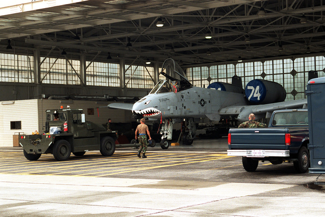 """An A-10A """"Warthog"""" of the 74th Fighter Squadron/23rd Wing is backed into a hangar for protection from Hurricane Fran. Due to maintenance problems the aircraft could not be flown out of Pope"""