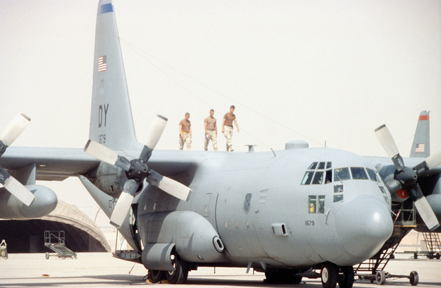 SENIOR AIRMAN Adam Brunkow, Aero Structure Repairman, and Airmen First Class Rian Capaci, and Ken Sergent, C-130 Crew Chiefs with the 4410th Airlift Squadron conduct a routine structure inspection on a C-130 Hercules. This is part of the relocation of Operation Southern Watch and the 4404th Wing (Provisional ) from Dhahran after a terrorist bomb killed 19 Air Force personnel in June