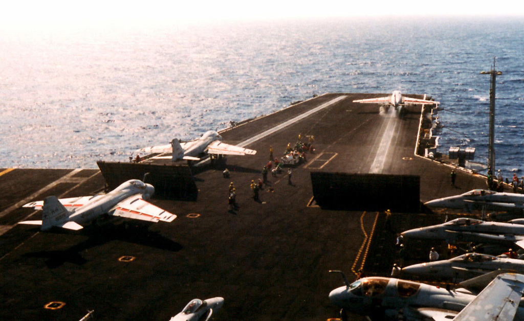 """An US Navy VA-75 (Attack Squadron Seven Five, the """"Sunday Punchers"""") A-6E Intruder launches from Catapult One onboard the USS ENTERPRISE (CVN-65), while two other VA-75 A-6Es prepare for launch. The USS ENTERPRISE is attached to the Sixth Fleet and conducting flight operations in the Adriatic Sea in support of Operation Joint Endeavor. Operation Joint Endeavor is a peacekeeping effort by a multinational Implementation Force (IFOR), comprised of NATO and non-NATO military forces, deployed to Bosnia in support of the Dayton Peace Accords"""