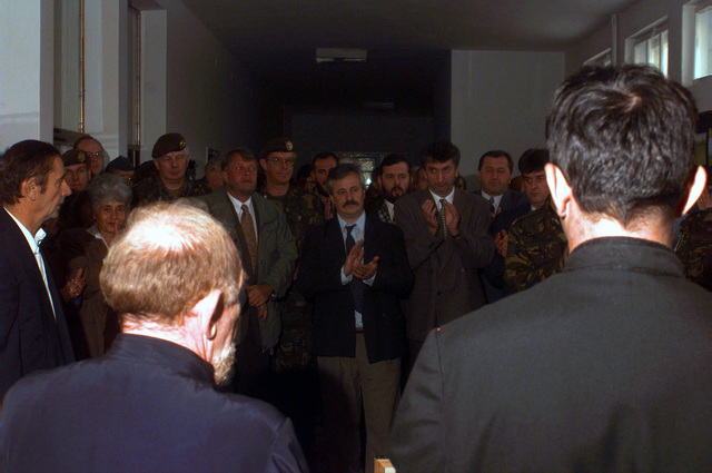 Civilians and Dutch Civil Affairs officers applaud the official reopening of the Radojka Lakic Primary School in Novo Sarajevo, Republika Srpska, during Operation JOINT ENDEAVOR (the multi-national peace mission in Bosnia)