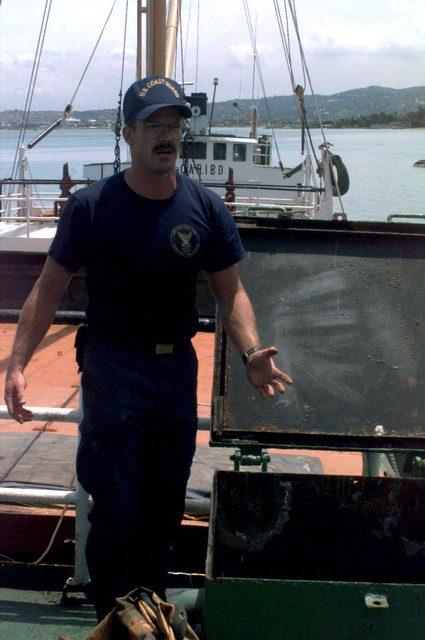 A member of The United States Coast Guard does a walk through on a boat which the Haitian Coast Guard seized from Panama that was carrying about 585 Kilograms of cocaine. Shown here is an area of the seized boat that was searched