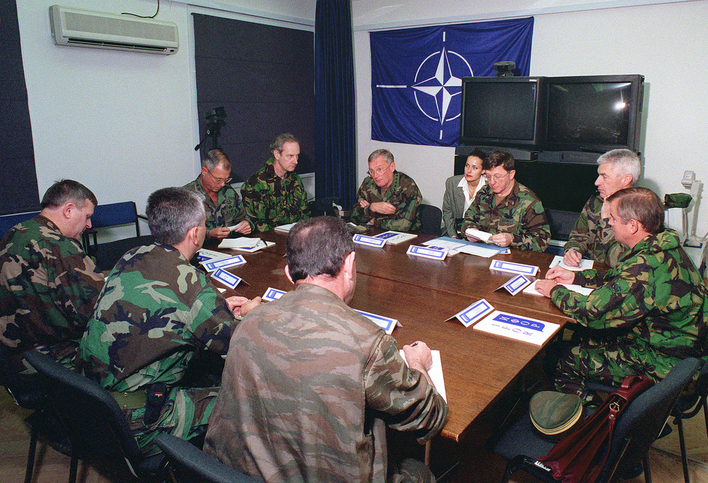 General John M. Shalikashvili, United States Army, Chairman Joint Chiefs of STAFF, meets for the first time with the military leaders of the former warring factions. Counter-clockwise from the right is Brigadier General Charleton-Weedy, United Kingdom Army, Head of the Allied Rapid Reaction Corps (ARRC) Faction Liaison Office; Lieutenant General Jean Heinrich, French Army, Implementation Forces, Deputy Commander; Admiral T. Joseph Lopez, United States Navy, Allied Forces Southern Europe, United States Naval Forces Europe and Implementation Forces (IFOR) Commander; General Shalikashvili; Major General Tim Sulivan, United Kingdom Army, ARRC CHIEF of STAFF; Lieutenant General William...