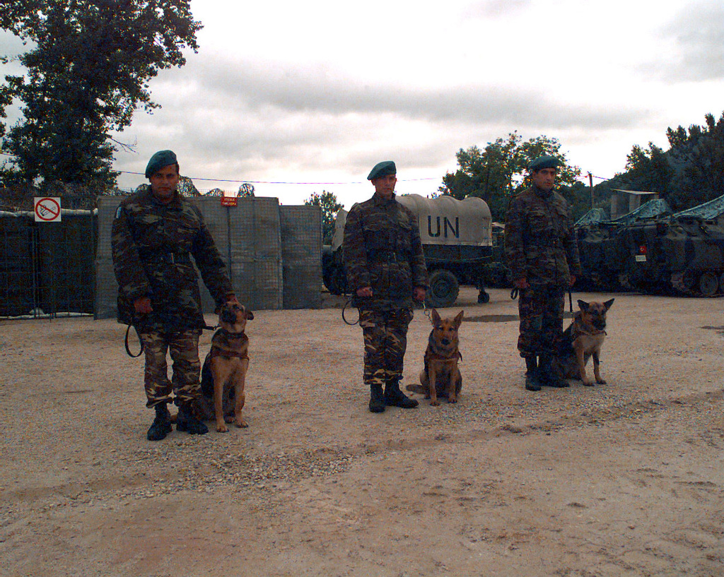 Turkish Army dog handlers stands next to their German Sheppard mine-sniffing dogs. The Turkish Army uses these dogs to find various types of buried mines in the Turkish Brigade Area of Task Force Eagle, located around Zenica, Bosnia-Herzegovina, during Operation Joint Endeavor. Operation Joint Endeavor is a peacekeeping effort by a multinational Implementation Force (IFOR), comprised of NATO and non-NATO military forces, deployed to Bosnia in support of the Dayton Peace Accords