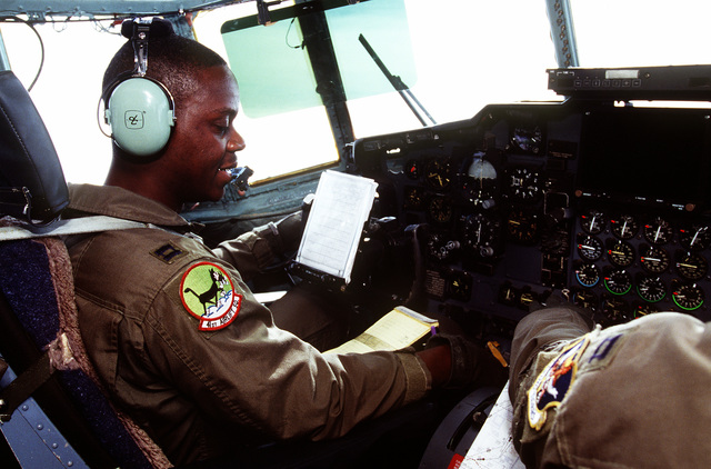 Aircraft Commander Captain Kirby Haynes of the 41st Airlift Squadron, Pope Air Force Base N.C. checks cockpit control panels during a flight into Tuzla Air Base to deliver supplies