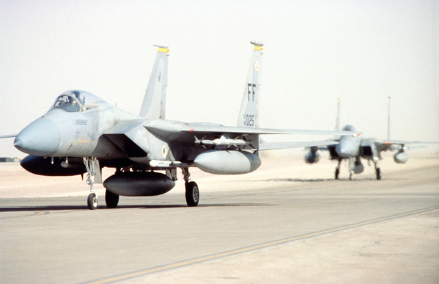 An F-15C Eagle, with the 27 Fighter Squadron, Langley Air Force Base Virginia, taxies for the first time at the new deployed home of the 4404th Wing (Provisional). The F-15s are providing fighter support during the relocation of Operation Southern Watch from Dhahran after a terrorist bomb killed 19 Air Force personnel in June