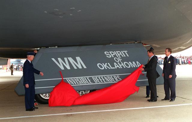 GEN. Richard Hawley, ACC Commander; Senator Infofe; and Mr. Ken Cressa unveil a B-2 Stealth Bomber, the Spirit of Oklahoma