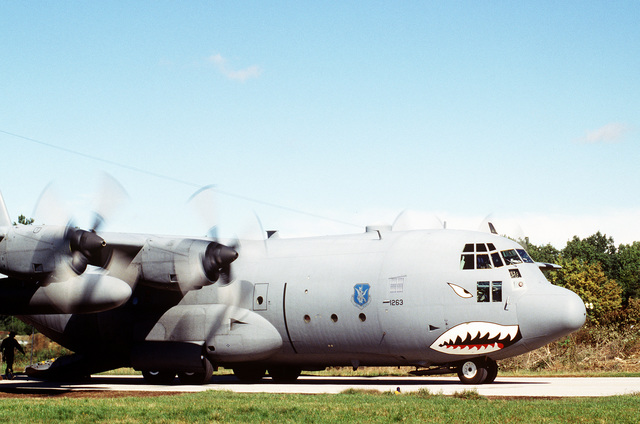 A USAF 86TH Air Wing C-130 taxies, with its rear loading ramp lowered, along the tarmac at Tuzla Air Base, Bosnia-Herzegovina. The 86th is in support of forces involved in Operation Joint Endeavor, which is a peacekeeping effort by a multinational Implementation Force (IFOR), comprised of NATO and non-NATO military forces, deployed to Bosnia in support of the Dayton Peace Accords. (Duplicate image, see also DD-SD-00-00391 or search 960914-F-3939J-505)