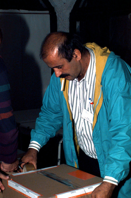 Capljina polling station representative, Sabanovic Muhamed, seals ballots boxes after the Bosnia and Herzegovina elections during Operation JOINT ENDEAVOR